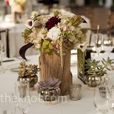 Centerpieces included hydrangeas, calla lilies and roses, mirroring the bouquets.