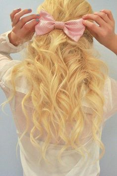 Curls half up half down with a bow