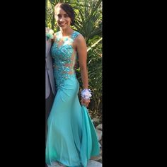 Sheer beaded prom dress Teal high neck sheer beaded prom or formal long dress. Only used once. Women's size small (4) price negotiable! Gorgeous fitted and flowy towards the bottom but not poufy Dresses Prom