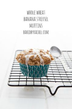 Moist whole wheat banana muffins with a crunchy streusel topping and sweet vanilla glaze.