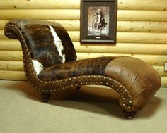 Custom leather and cowhide chaise lounge from CrossBarGallery in the Oklahoma City Stockyards. Gorgeous!!