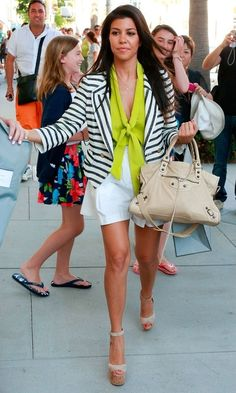 Kourtney Kardashian summer street style with blazer and shorts.