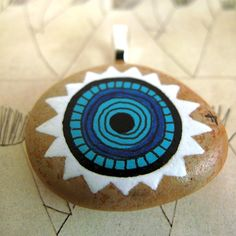painted stone / turquoise sun / pendant /  RESERVED via Etsy