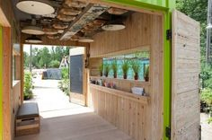 Bright Green Shipping Container Hut Welcomes Visitors to Evergreen Brickworks In Toronto