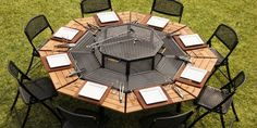 It's a fire pit, table, and BBQ grill — all in one!