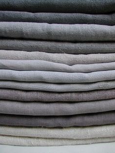 under no obligation. stack of gray linens