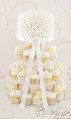 Glamorous white cupcakes with lace and pearls #wedding #weddingcupcakes #cupcaketower #white #vintage