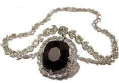 The cursed black Orlov Diamond, also called the Eye of Brahma, was stolen from a Hindu shrine by a monk. The gem has been passed down to multiple female owners, many of whom took their own lives. At least two of the women who took possession of the Orlov Diamond leapt to their deaths from a tall building. The curse was brought to light when the curator of a London museum uncovered the stone, with a note attached about it's history.