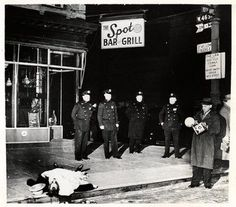"Murder victim outside ""The Spot Bar and Grill"" December 9, 1939. The photo is by Weegee, whose real name was Arthur Felig, a freelance press photographer."