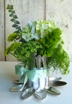 Egg holder centerpiece made from old silver spoons and a vase.