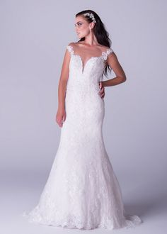 Viola Chan wedding dress, Lace mermaid dress with beaded back detail and breath taking statement train.