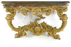A pair of important Italian Rococo carved giltwood console tables<br>Sicily or Naples, second quarter 18th century | Lot | Sotheby's