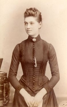 Victorian lady c.1888. Photo by Arthur Winter. This dress is all about the trim