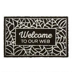 """One of my favorite discoveries at ChristmasTreeShops.com: """"Welcome To Our Web"""" Coir Door Mat"""