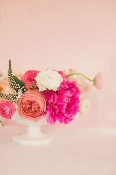 Peonies, garden roses, and ranunculi in pink hues