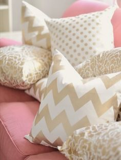Pink couch and white and gold. Love it!