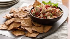 A fresh twist on chicken salad--easy to make for an appetizer with crackers or perfect on a bed of greens as a salad.