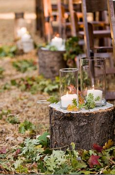 SO CUTE!!     You just need some stumps and pile leaves around the bottom. Then they put down a doily on the top placed more leaves/twigs with leaves on top then added a candle inside a tall vase/candle holder. Then added some more vases/candle holders around the bottom of the stump