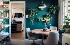 #plantwall Green plant wall. Blue Green accent wall. Mid century boho style. Kitchen interior design.