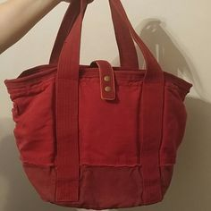 """Gap """"Red"""" canvas bag Gap """"Red"""" canvas bag in excellent condition.  Carried only a handful of times.  Too big for my needs.  Double straps (2"""" wide, 23"""" long) with a snap closure (2 snaps to choose length/width of closure).  The bag measures 10.5"""" depth, 20"""" wide, 13.5 """" tall.  Very roomy!  Zipper pocket and key ring tie inside.  No rips or stains. GAP Bags Satchels"""