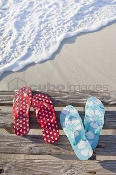 Flip flops on pier by sea