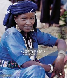 Stock Photo : Ethiopia, Shewa Province, Senbete. A woman at Senbete market wears old silver and brass jewellery. Her two pendants are made from Maria Theresa thalers- old silver coins minted in Austria, which were widely used as currency in northern Ethiopia and Arabia