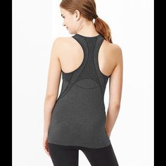 GapFit racerback tank Color: charcoal heather GapFit Motion heathered racerback tank Fabric: 67% Nylon, 25% Polyester, 8% Spandex. Machine wash.  Seamless - no seams = no chafing. Silky to the touch with resilient recovery properties. Strategically placed ergonomic mesh panels ventilate sweat-prone areas and visually map a slimmer waistline. Designed for your most rigorous workouts, including running, boot camp, and spinning. Banded scoop neckline. fit & sizing Slim silhouette fits close to…