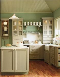Color combination - Country Kitchens With White Cabinets - I don't like the cabinet style, but I do like the idea of antique white cabinets, sage green walls, and hardwood floor - in the right home, this could be perfect, but it's maybe my 3rd or 4th choice   *********************************************   Kitcheninstallation - #kitchen #cabinet #color