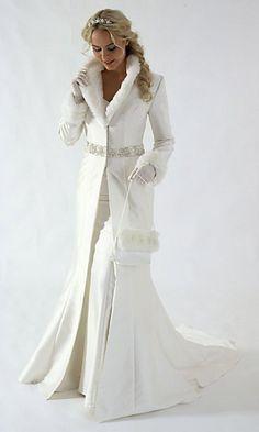 An elegant white winter wedding fur dress