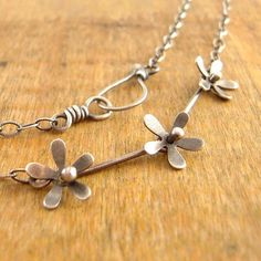 Silver flower necklace. Hand-cut sterling silver by erinbowe
