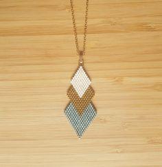Sautoir doré à l'Or fin 14 carats ( plaquage gold filled ) et tissage en perles…