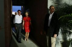 127 10/6/12 Republican presidential candidate and former Massachusetts Gov. Mitt Romney and his wife Ann walk backstage before his campaign appearance in Apopka, Fla. on Saturday, Oct. 6, 2012. ((AP Photo/Charles Dharapak))