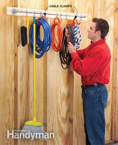 Is your garage stuffed to the gills with stuff? Nearly everyone's garage can use some organizing and we've got some simple and clever tips to help you do it! Diy Garage Storage, Cord Storage, Clothes Storage, Storage Ideas, Shop Storage, Vacuum Storage, Hanging Storage, Storage Bins, Storage Rack