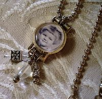 ~ The Feathered Nest ~: Old watch face with a photo inserted and hung on a chain with beads