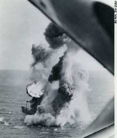 Japanese 4500-ton cargo ship exploding under a bombing attack from US carrier aircraft off the coast of French Indochina 12 January 1945.