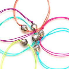 http://www.bellabeachjewels.com/collections/beach-bangles/products/mini-scallop-shell-bracelets