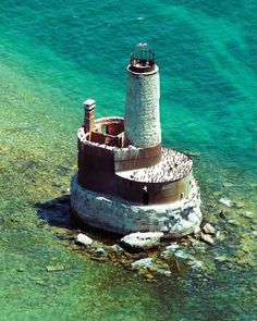 Waugoshance Lighthouse: This Emmet County light is one of the 100 lighthouses along the Lake Michigan shore photographed from the air by Marge Beaver.