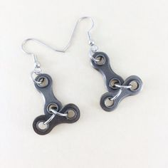 I love these fun upside down T bike chain earrings. The bicycle chain is recycled. You will receive the earrings in the photo. The dangle part of the earrings is about 1.1 inches (3 cm) high by 0.8 inches (2.1 cm) wide. The earring wires are surgical steel. To see more cycling jewelry http://www.etsy.com/shop/WanderingJeweler?section_id=7952868