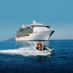 Voyager of the Seas - a young couple jet-ski off a Caribbean coast, in the background is the huge Voyager of the Seas cruise ship from Royal Caribbean International - find out more at http://the-cruise-specialists.co.uk/c/line-display/?cruiseline=Royal%20Caribbean&client=the-cruise-specialists&nLin=26