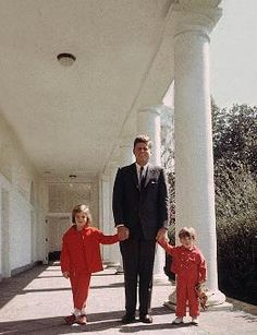 daughter Caroline, President JFK and son John Jr. at the White House in this undated photo