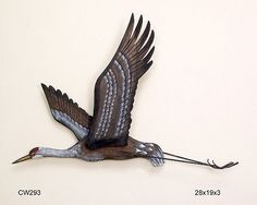 (http://www.shopbeachdecor.com/products/Sandhill-Crane-Flying.html)