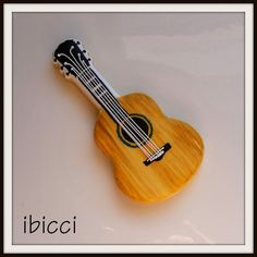 Beautiful wood grain guitar cookie! By Ibicci