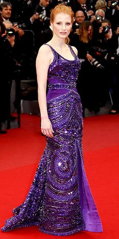 JESSICA CHASTAIN No Elizabeth Taylor jewels needed for this gown. Jessica stuns in a fully beaded purple Givenchy by Riccardo Tisci creation that complements her pretty red pony at the All is Lost premiere.2013 Cannes Film Festival