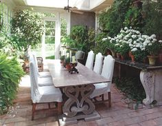 Garden Room ~ ornate marble console & table, brick floor and linen chairs ~ lovely.