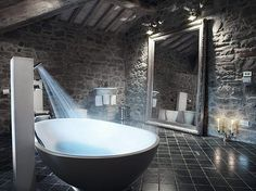 I love the stone look, and the shower head being used to fill the bathtub.