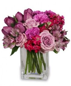 Lavender roses and purples tulips with some carnations in lavender and fuscia stock $65.00