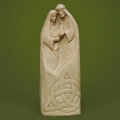 """Our resin figurine features a unique stone look and texture, with Trinity Knot design. A perfect addition to your Irish Christmas décor. Measures 8 3/4"""" high."""
