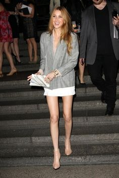 The grey blazer and white skirt