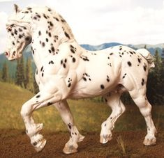 Sugarbush draft horse =  sculpted by Debbie Lermond and painted by Lisa Bickford in 2009