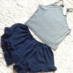 John Galt Set Grey crop ribbed tank One Sz NWT $20 Navy Ruffle Vodi Shorts One size (XS) NWT $17 Brandy Melville Tops Crop Tops